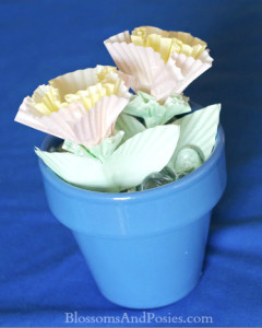 Super cute flowers made from cupcake papers! You can use these as Valentines too - just open the leaves and write your message!