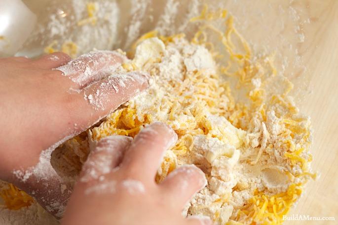 mix dough with hands - BlossomsAndPosies.com