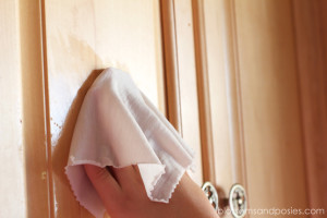 wiping cupboards